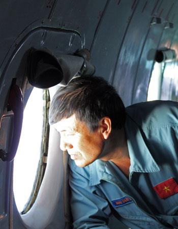 A Vietnamese serviceman scans the South China Sea.