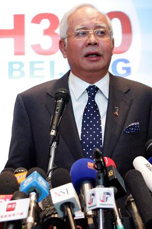Prime Minister Najib speaks to the press.