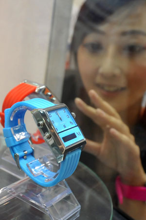 A model in Taiwan admires a voice command watch from Martian.