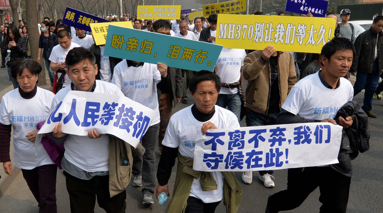 Relatives stage a protest outside the Malaysian embassy in Beijing.