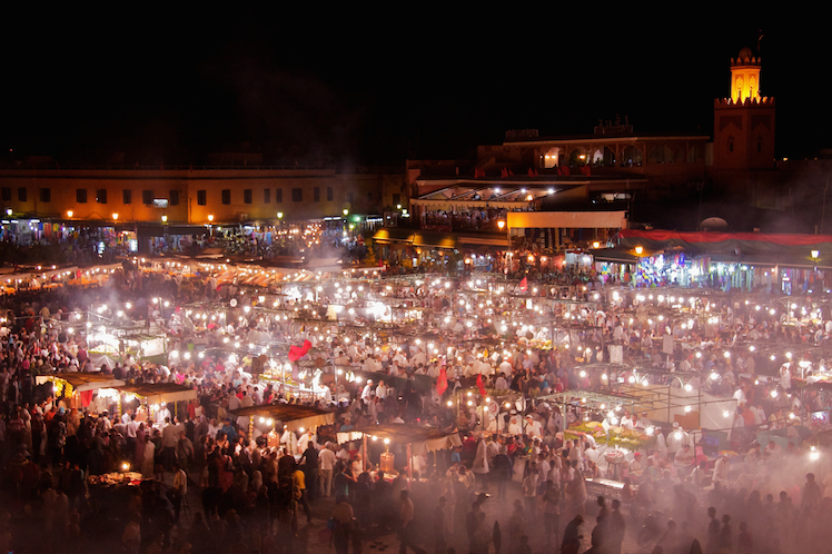 The festival-like energy of Jemaa el Fna Square at night. Photo: Shutterstock