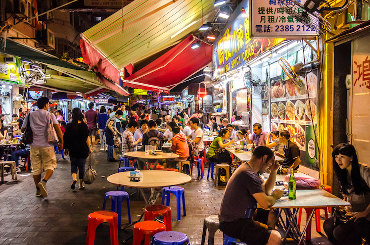 Visitors enjoy cheap and cheerful meals at one of Temple Street's many restaurants. Photo: Shutterstock
