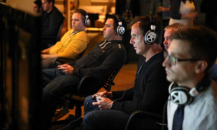 Actor Will Arnett tests out the multiplayer action.