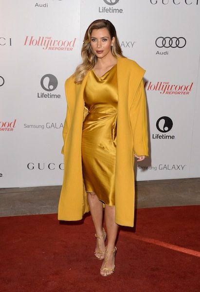 Kim Kardashian pairs her silk dress with a wool coat to mix it up.