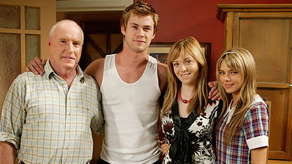 Evans (far right) on the 'Home and Away' set with Chris Hemsworth (second from left).