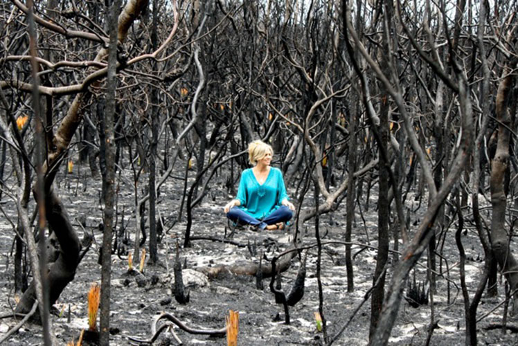 Emily Rooney poses amid the aftermath of the Canberra bushfires. Source: Supplied.