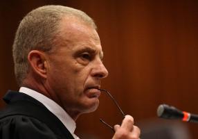 State prosecutor Gerrie Nel  cross-examines Oscar Pistorius. Picture: AAP