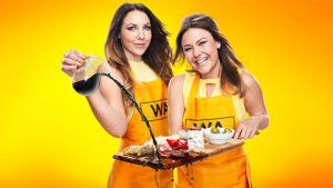 Contestants Chloe and Kelly in the midst of MKR.