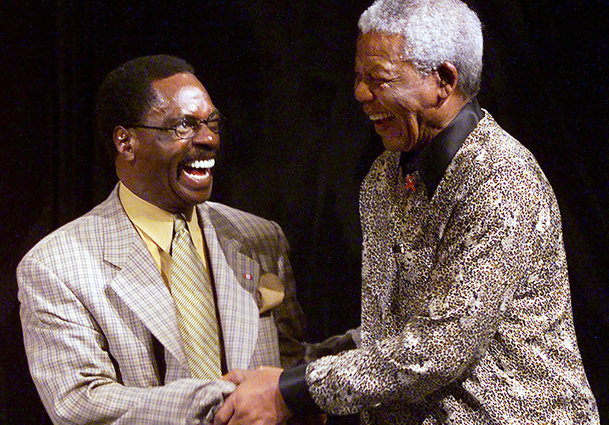 """Nelson Mandela shakes hands with the """"Hurricane""""."""