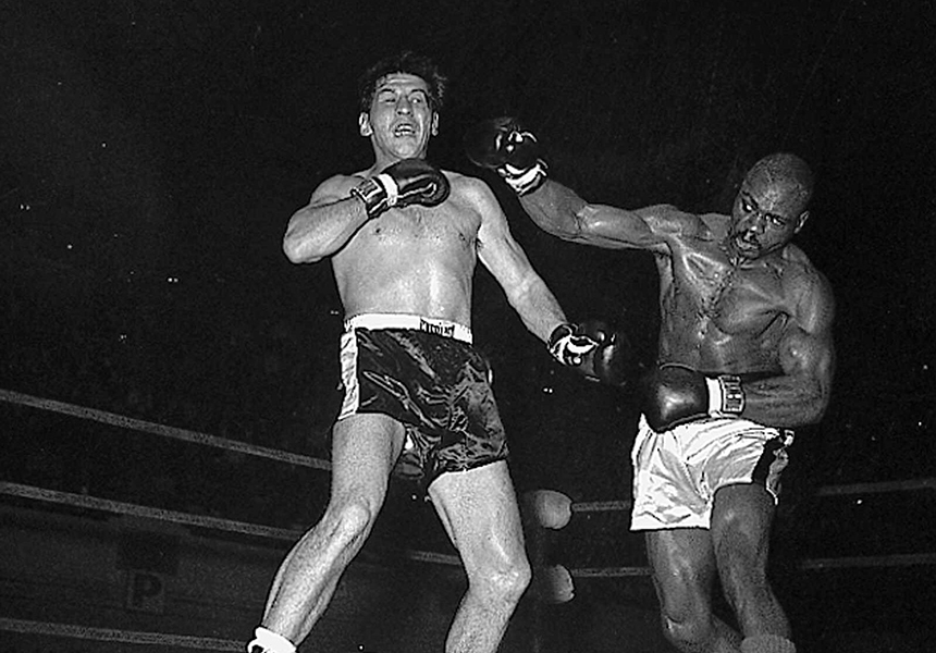 """Joey Giardello and """"Hurricane"""" Carter in the ring."""