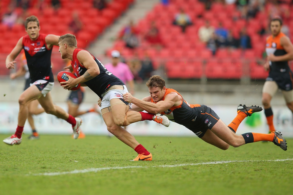 Heath Shaw throws himself into tackling Melbourne's Dean Kent.