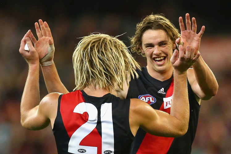 Dyson Heppell (No. 21) and Joe Daniher celebrate another Essendon goal. Photo: Getty
