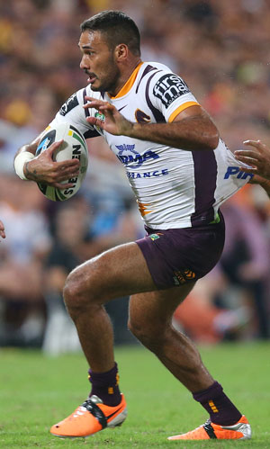 Justin Hodges of the Broncos makes a break. Photo: Getty