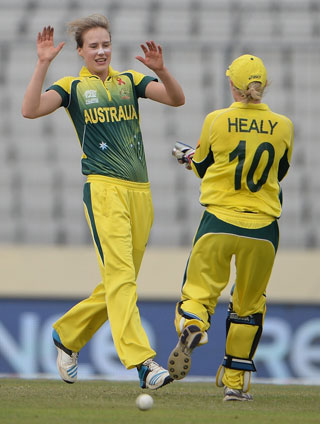 Ellyse Perry and Alyssa Healy celebrate another England wicket. Photo: Getty