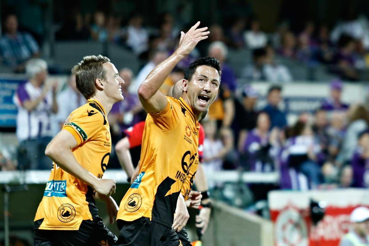 Jacob Burns of Perth Glory celebrates a goal against the Mariners.