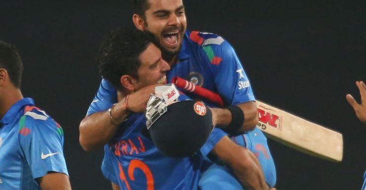 Virat Kohli is hugged by Yuvraj Singh after he hit the winning runs in the semi-final.