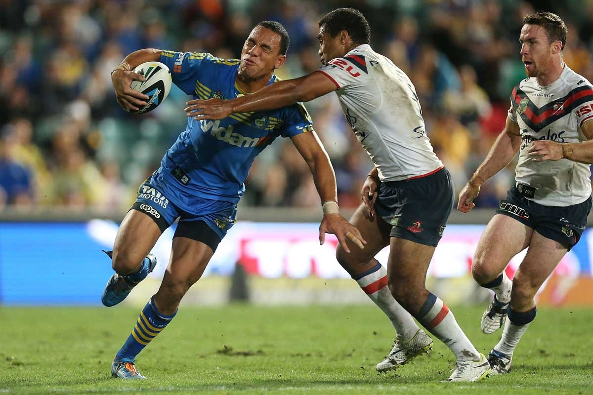 Will Hopoate of the Eels is tackled by Michael Jennings of the Roosters during the round 6 NRL match between the Parramatta Eels and the Sydney Roosters at Pirtek Stadiu...