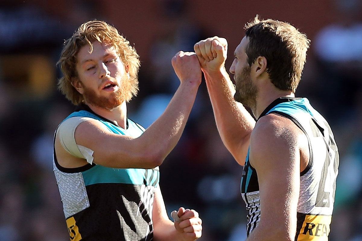 Jay Schulz (R) of the Power celebrates after kicking another goal.