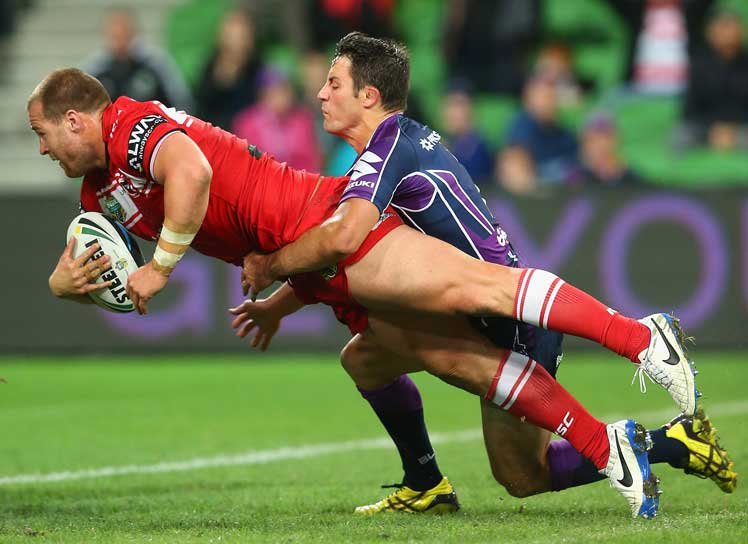 Trent Merrin of the Dragons dives to score a try despite the best efforts of Cooper Cronk. Photo: Getty
