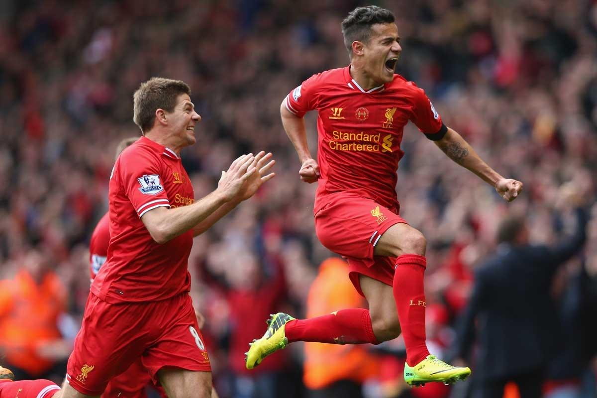 Philippe Coutinho of Liverpool celebrates scoring his team's third goal.