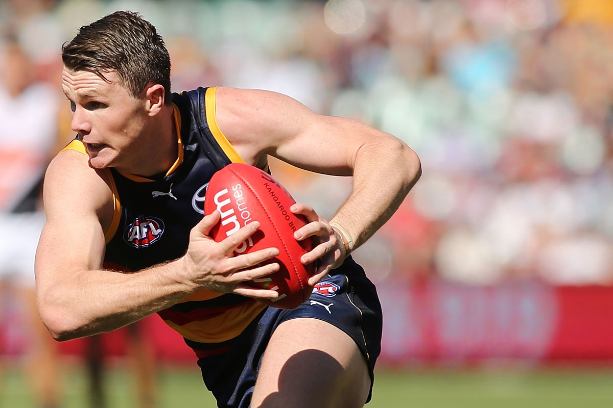 Patrick Dangerfield burns some rubber at the Adelaide Oval.