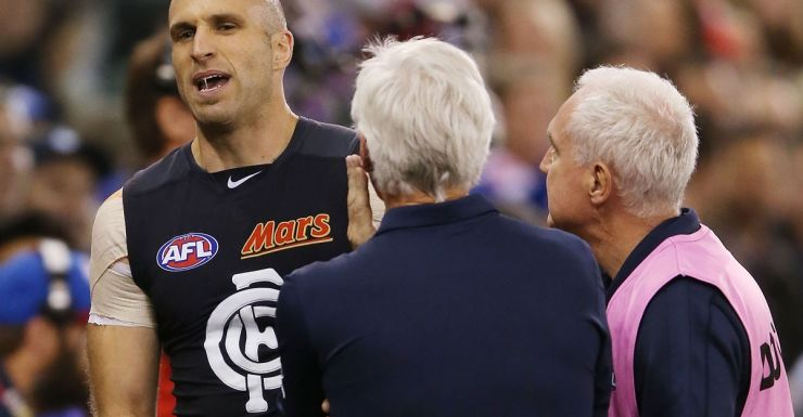 Chris Judd talks to Mick Malthouse after coming off with a hamstring injury.