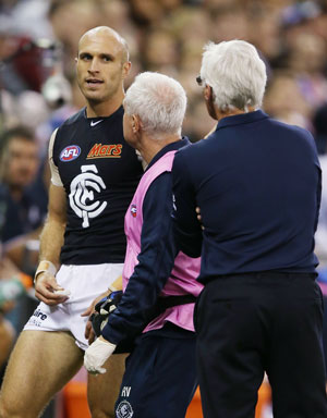 The eyes have it: A hamstrung Chris Judd and coach Mick Malthouse. Photo: Getty