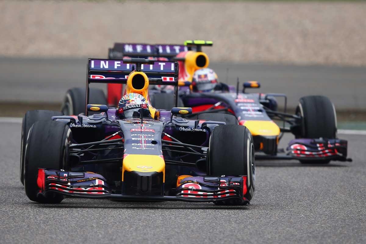 Sebastian Vettel of Germany in the way of Australia's Daniel Ricciardo.