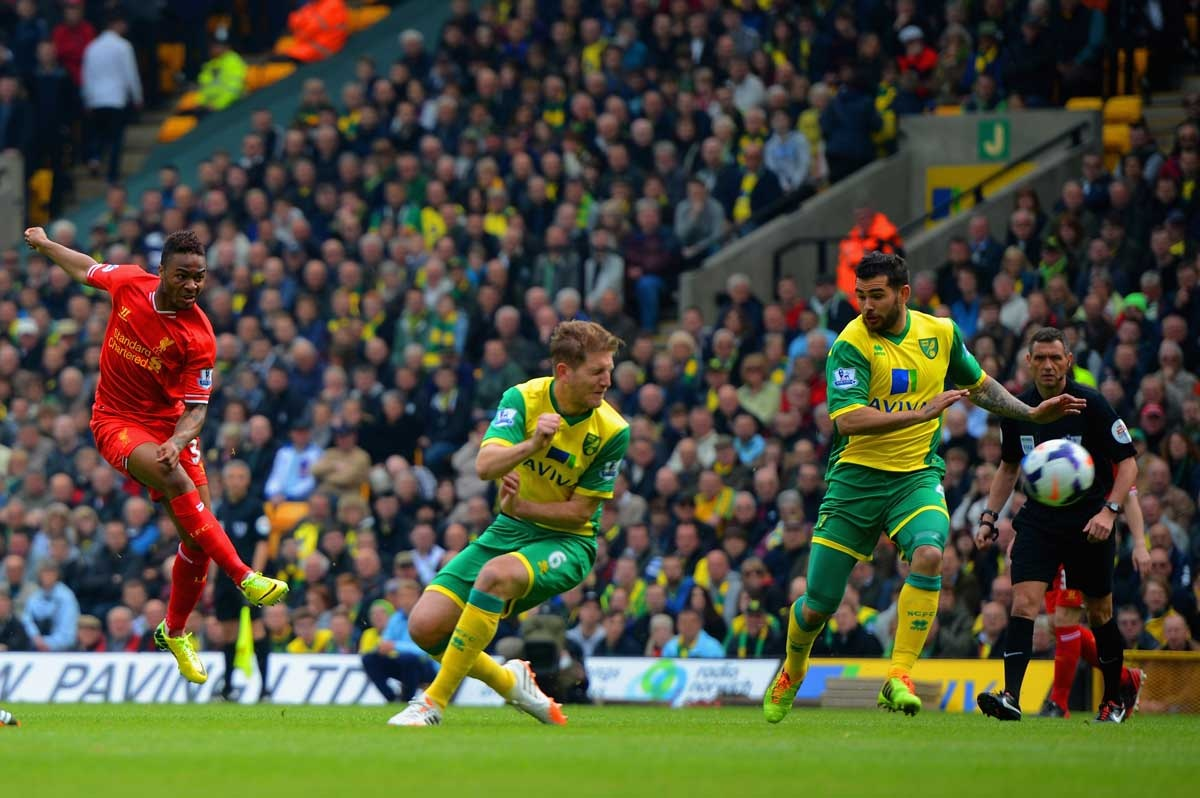 Liverpool's Raheem Sterling scores the opening goal against Norwich.