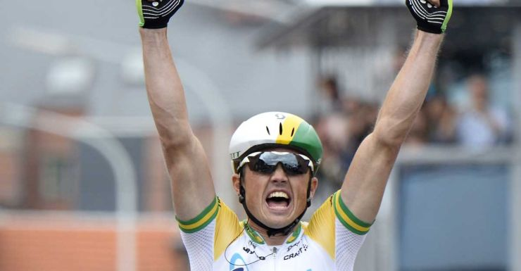 Simon Gerrans crosses in first place.