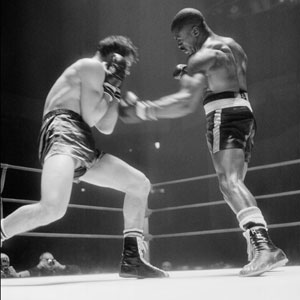 Carter lands a punch on Italy's Fabio Bettini in 1965.