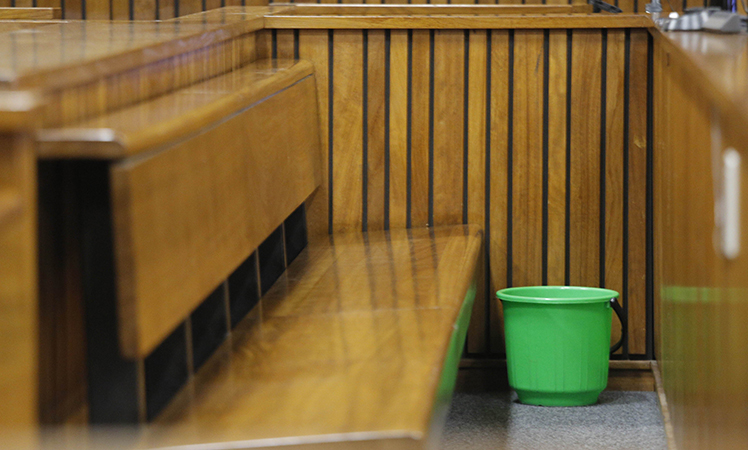 A bucket was placed next to Pistorius in the courtroom.