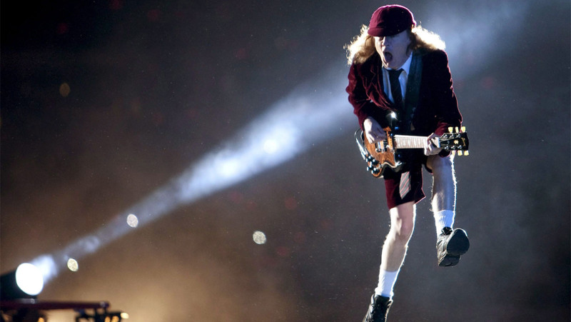 Angus Young onstage with  AC/DC.