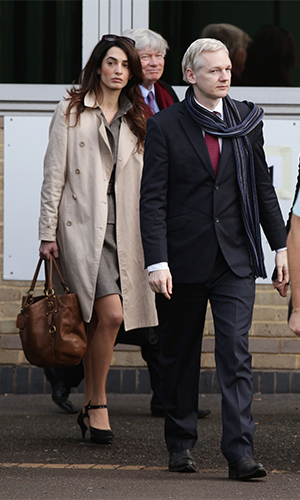 Amal Alamuddin with client Julian Assange and colleague Geoffrey Robertson. Photo: AAP