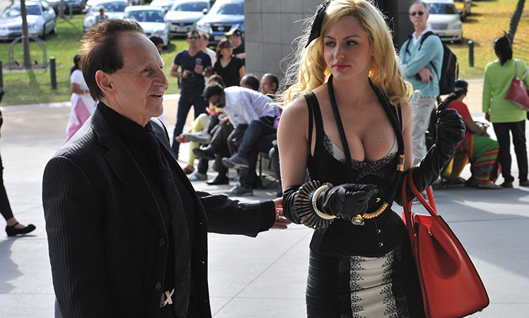 Geoffrey Edelsten arrives with New York model Gabi Grecko.
