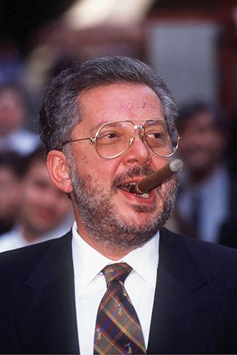 The late stockbroker Rene Rivkin with his trademark cigar. Source: Getty