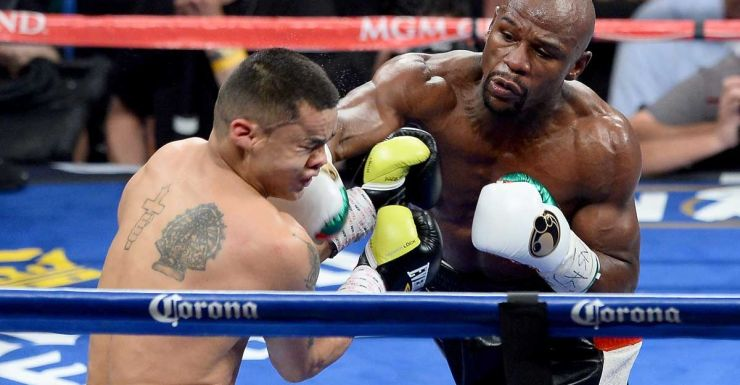 Floyd Mayweather Jr. hits Marcos Maidana with a right.