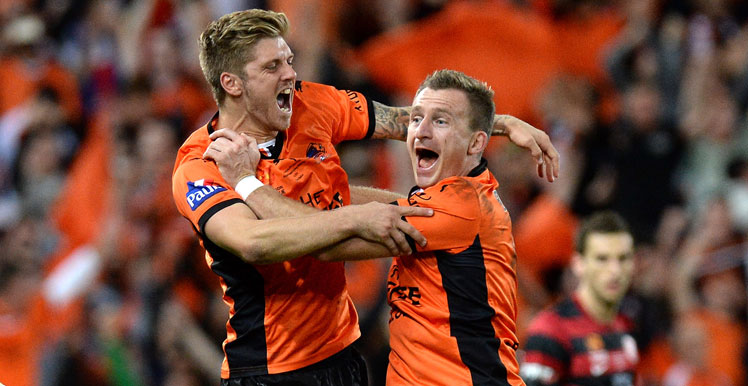 Full-time: Luke Brattan (L) and Besart Berisha of the Roar celebrate victory as the siren sounds the 2014 A-League Grand Final. Photo: Getty