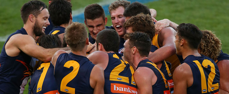 Josh Kennedy is mobbed by West Coast teammates after kicking his 10th goal. Photo: Getty