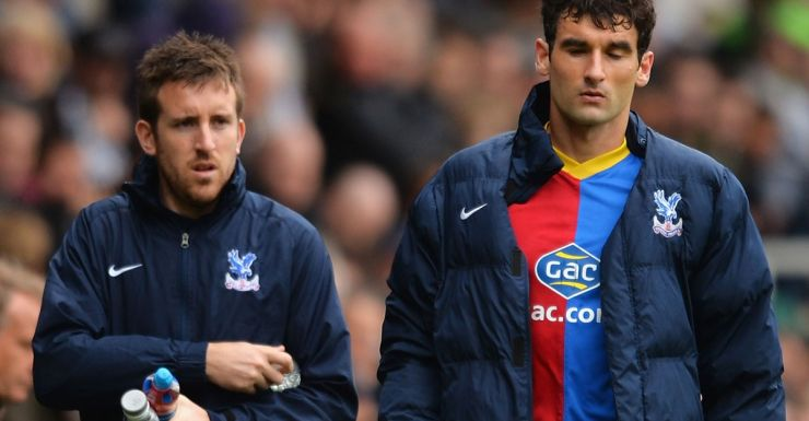 Mile Jedinak goes off injured for Crystal Palace.