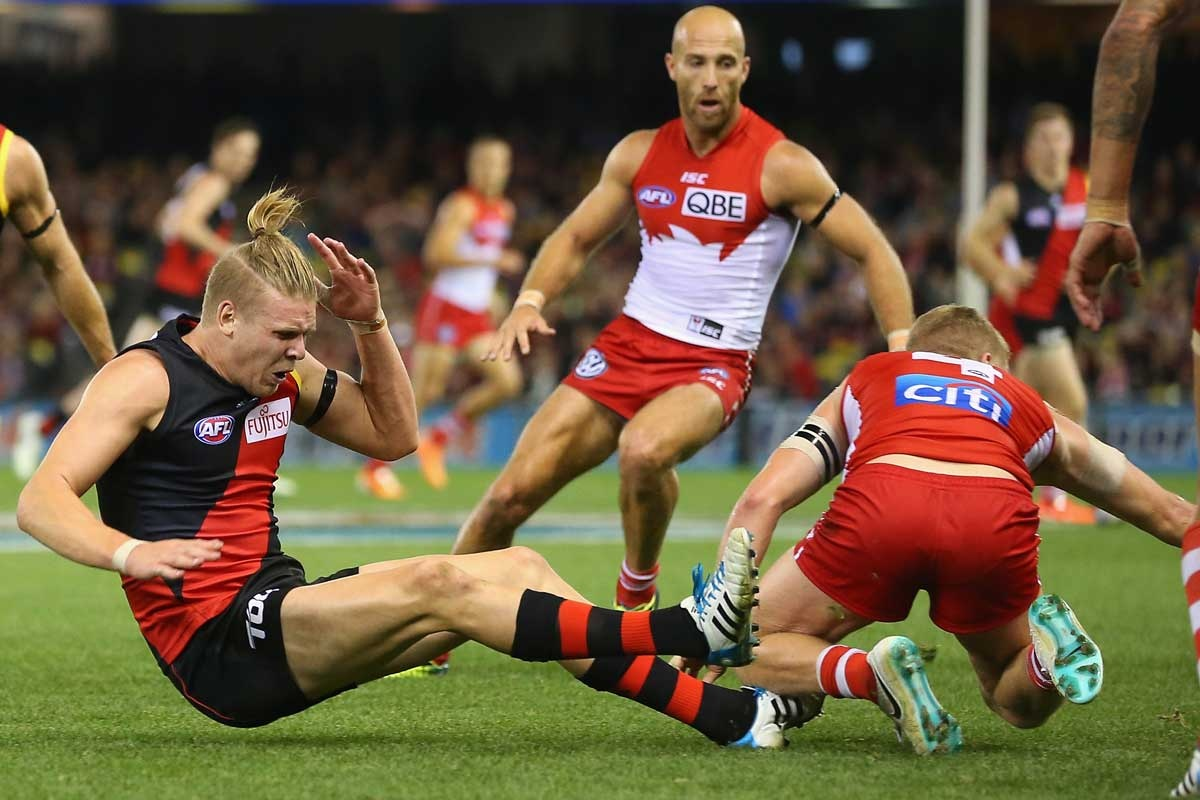 Ouch! Michael Hurley feels the pain after Dan Hannebery crashes into him.