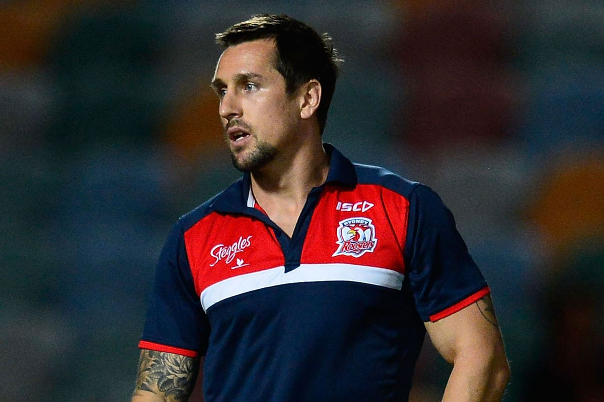 Disgraced Mitchell Pearce looks on from the sidelines.