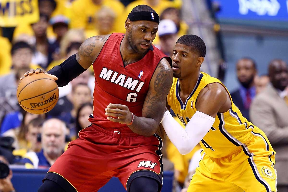 Pacers star Paul George defends against LeBron James.