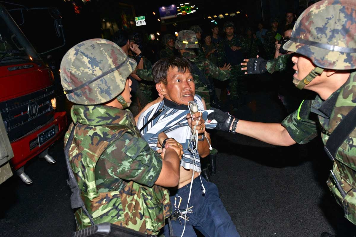 A protester is arrested by the Thai military.