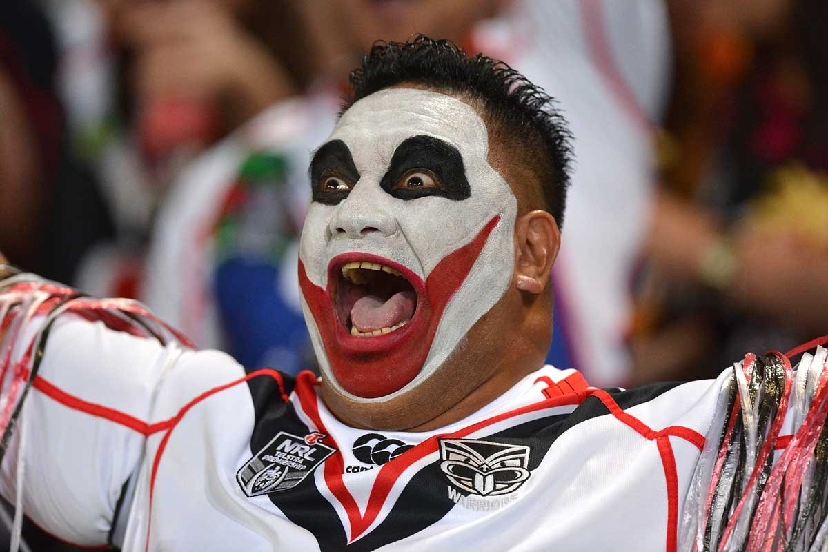 A Warriors fan celebrates the 'away' victory.