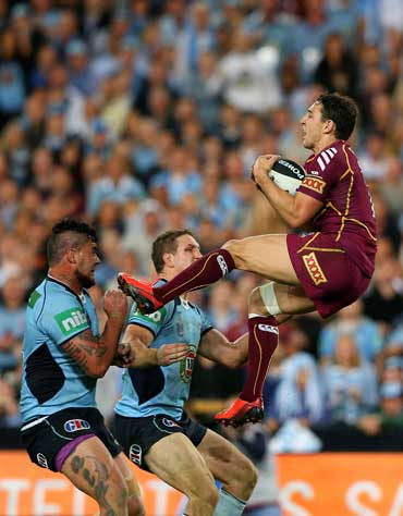 The Queensland star stakes a high ball during the 2013 Origin series. Photo: Getty