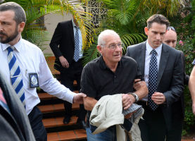 Rogerson faced a wall of cameras outside his home.