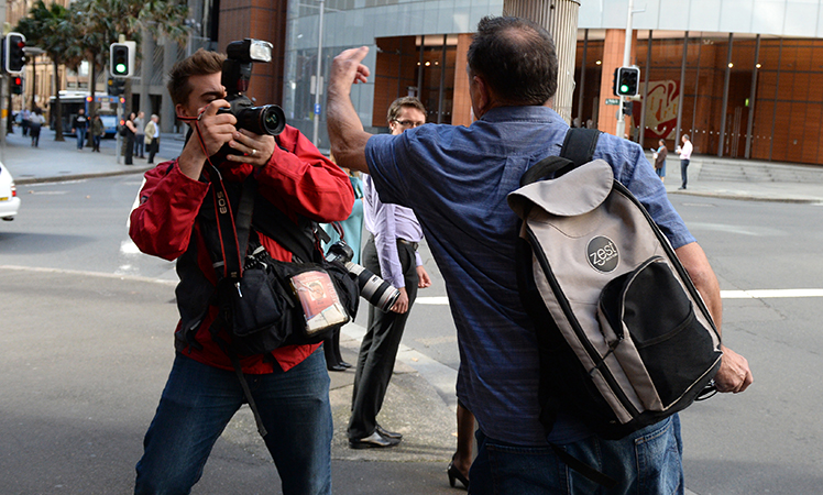 Former union official Bruce Wilson lashes out at a photographer. Photo: AAP
