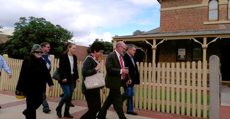 Member for Mildura Peter Crisp and his supporters arrive at Wentworth Local Court where the MP faced nine firearms charges.
