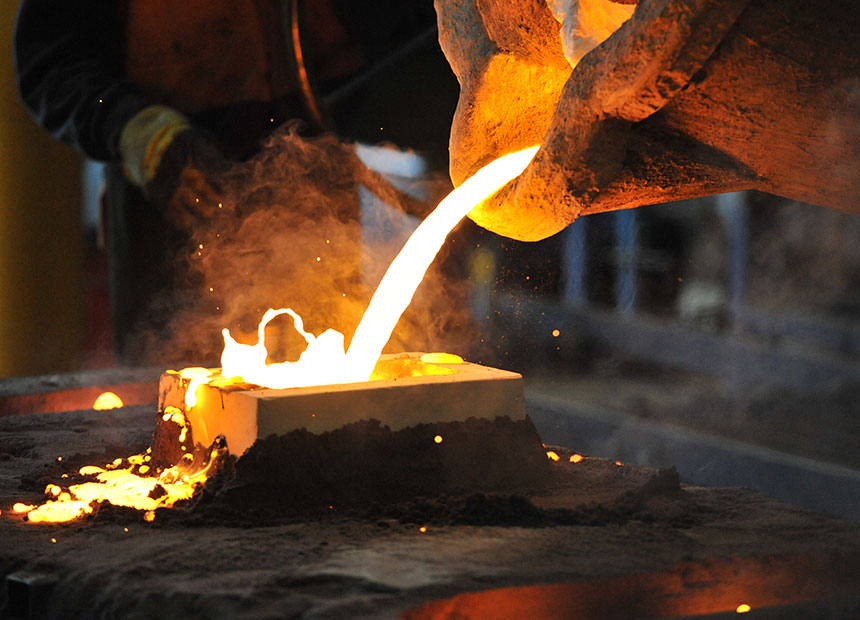 A factory worker pours molten iron at Backwell IXL in Geelong in Geelong.